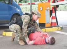Staff Sgt. Alexandra Shipway, MP patrol supervisor, 554th MP Co., assesses a simulated victim, Sept. 16, during Stallion Shake 2017. Photo by Kevin S. Abel, USAG Stuttgart Public Affairs