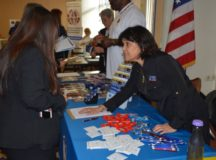 """Mary """"Tweedy"""" Knef tells attendees about the many aspects of FMWR and offers retirees some useful swag during RAD 2017, Oct. 19. Photo by John Reese, USAG Stuttgart Public Affairs"""