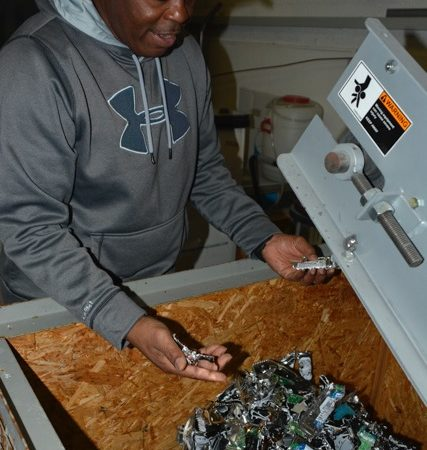 CDDF manager Curtis Burgress demonstrates how the hard drive shredder turns drives into scrap metal.