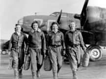 """Four Women Airforce Service Pilots return from their B-17 Flying Fortress,  """"Pistol Packin' Mama,"""" at the four-engine school at Lockbourne Army Airfield, Ohio, during World War II."""