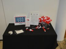 A display next to the memorial wall offers forms to remember loved ones and paper poppys. Photo by John Reese, USAG Stuttgart Public Affairs
