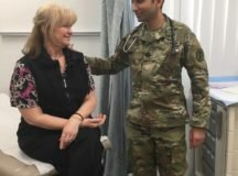 Dr. (Capt.) Azfar Syed, Patch Clinic, discusses a routine colorectal cancer screening with patient Constance. The anxiety before a screening is worse than the actual event. Photo by Staff Sgt. Diana Anderson, U.S. Army Health Clinic