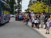 Students, teachers and parents give a rousing sendoff to the column of buses leaving for the last time of the school year. Photo by John Reese, USAG Stuttgart Public Affairs