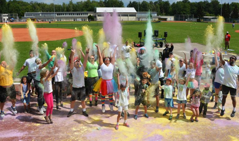 Participants make their own rainbow of colored chalk to end the Pride Month 5k Color Run, June 23. Photo by Larry Reilly, USAG Stuttgart Public Affairs