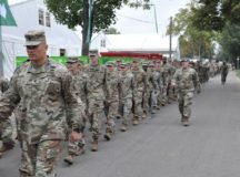 U.S. military personnel, including Garrison Command Sergeant Major Toese Tia Jr. (foreground left), march to the tent hosting the 43rd annual Soldiers' Fest at the Cannstatter Volksfest in Stuttgart.  Photo by Bardia Khajenoori, USAG Stuttgart Public Affairs