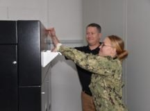 Petty Officer 3rd Class Sara Jacobs is one of the first customers in Europe to shred classified documents using the CDDF's new system, Oct. 15.  Photo by Larry Reilly, USAG Stuttgart Public Affairs.