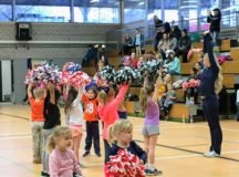 Present and future garrison community cheerleaders learn a pom-pom drill in the Patch Middle School gym, Jan. 30.