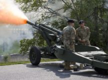 Spc. Sor Lo (left), a loader, and Spc. Oscar Sanchez (right), a cannoneer, of C Battery, 3rd Battalion, 16th Field Artillery Regiment, 2nd Brigade, 1st Cavalry Division, fire a 105mm Howitzer as part of a 13-gun salute during First Army Division East's Change of Command and Change of Responsibility ceremony, June 26, 2019 at Fort Knox. The salute was in honor of Maj. Gen. Todd McCaffrey, the outgoing First Army Division East commanding general. (U.S. Army photo by Sgt. 1st Class Gary J. Cooper / 4th Cavalry Multi-functional Training Brigade) (Photo Credit: Sgt. 1st Class Gary J. Cooper)