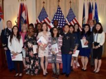 Twelve military and spouse candidates from around Germany became American citizens at Patch Barracks, USAG Stuttgart, during a naturalization ceremony the Panzer Community Club, July 18.
