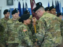 Col. E Lee Bryan passes the colors of the Army Health Clinic Stuttgart to incoming commander Lt. Col. Maria Bruton, during the Aug. 21 change of command ceremony at Patch Barracks. Photo by Rey Ramon, Visual Information Specialist, 7th Army Training Command