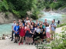 Stuttgart youth pose for a group photo along the Loisach River, Garmisch-Partenkirchen, while participating in a recent CYS R2 retreat training.