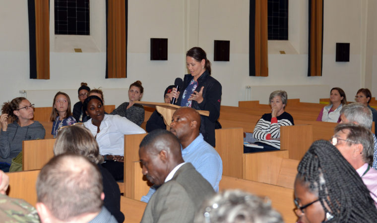 A community resident asks a question during the housing town hall, Sept. 23.