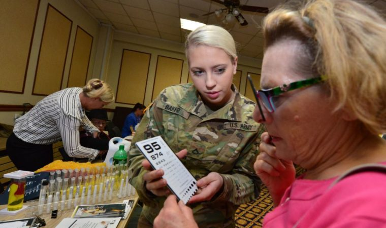 Pfc. xxx Baker, xxxx, assists veterans and family members at RAD 2019, Oct. 17.