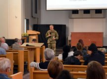 Col. Jason W. Condrey, commander, USAG Stuttgart, addresses audiences in the Panzer Kaserne chapel and on a live Facebook feed. Photos by Larry Reilly, USAG Stuttgart