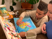 Nine-year-old Marco prepares artwork intended for senior citizens' homes in the greater Sindelfingen area