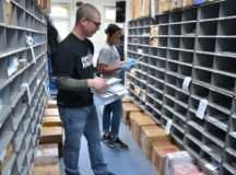 Active Military volunteers help process mail during COVID-19. Photo by Rick Scavetta, USAG Stuttgart Public Affairs.