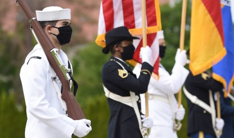 Members of the U.S. European Command honor guard perform during a private Memorial Day ceremony on Patch Barracks in Stuttgart, Germany. The ceremony was private in the hopes of recording it and broadcasting to the community, who remain socially distanced due to COVID-19. (U.S. Air Force photo by Staff Sgt. Krystal Wright)