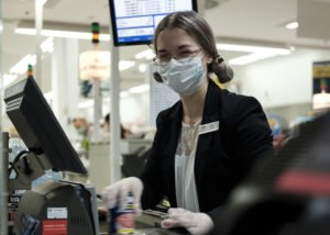 a commissary teller, scans a customer's purchased products
