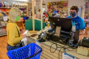 A customer buys art supplies at the Arts and crafts center