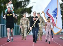An Army family from the Stuttgart Army Health Clinic joins U.S. Soldiers for the Army's 245th Birthday Run/March on Patch Barracks. (Photo by Rey Ramon, TSC Stuttgart)