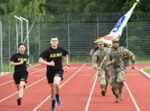 Soldiers assigned to the Stuttgart Veterinary Clinic run with the Army colors during a run for the 245th Army Birthday run at Panzer Kaserne, Boeblingen, Germany. U.S. Army Garrison Stuttgart celebrated the Army's birthday over the course of June 11-12, 2020 with a 24-hour run by teams from units in the Stuttgart area running in two hour blocks. (U.S. Army photo by Kenneth G. Takada)