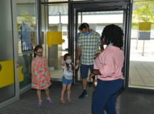 Principal Moss-Beaman greets a family as they enter Stuttgart Elementary school for an orientation, Aug 12. Photo by Geoffrey Morris.