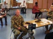 Lt. Col. Troy Baker, joins Col. Jason Condrey, the USAG Stuttgart commander, and local educators during a Aug. 20 livestream update on back to school measures. (Photo by Bardia Khajenoori, USAG Stuttgart)