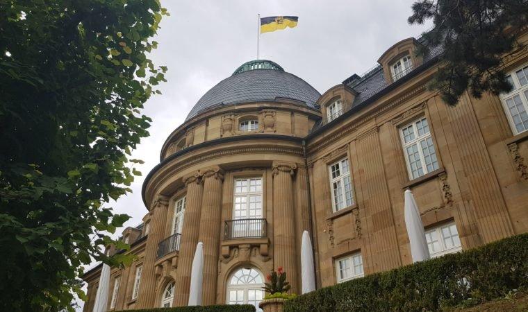 The flag of Baden-Württemberg flies above Villa Reitzenstein, the official seat of the state premier, in Stuttgart. Photo by Bardia Khajenoori, USAG Stuttgart Public Affairs.