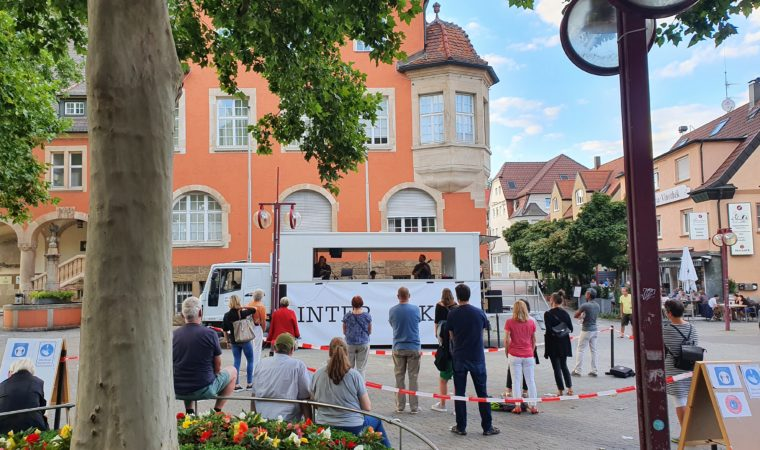 A physically-distanced crowd attends a musical performance in Stuttgart-Vaihingen on August 22, 2020. Rules that come into effect when a local district breaks coronavirus case thresholds impacts the number of people allowed at events. Photo by Bardia Khajenoori, USAG Stuttgart Public Affairs.