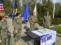 United States European Command Director of Logistics, Rear Adm. Duke Heinz, second from left, and fellow Sailors prepare to cut a cake in honor of the Navy's 245th Birthday on Oct. 13, 2020. Photo by Becca Castellano.