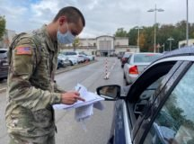 Pfc. Turner Donavon of 52nd Signal Battalion, takes customer forms