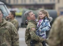 "CW3 Erik Herr carries his excited daughter on the annual 1-214th GSAB on their annual ""Family Safety Day"". Supported by the USO and other organizations, there was static displays, ""drunk karting"" an aircraft spillage demonstration and fire safety demonstration. March 16. 2018. Wiesbaden, Germany. (U.S. Army photo by Paul Hughes)"