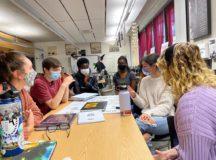 Photo by Geoffrey Morris, USAG Stuttgart Stuttgart High School Senior, Becky Rhoden, left, helps students brainstorm in Mrs. Shana Blankenship's yearbook class where she works as a teacher's aide.