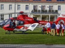 German paramedics prepare to load a patient onto an emergency medical helicopter in front of the USAG Stuttgart headquarters building on Panzer Kaserne, Feb. 23, 2021. Photo by Becca Castellano.