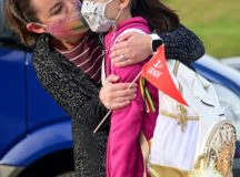 Kaymi Kurfis gives her daughter Taryn Kurfis a hug before her first day of first grade at Robinson Elementary School. Aug 2020. New mask guidlines allow for some exceptions to DoD mask mandates.