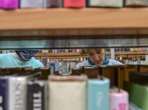Jennifer Fox peruses the book shelves at the Patch Library on June 15, 2021. Vaccinated community members can now enjoy all the library has to offer without face masks. Photo by Becca Castellano