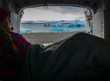 Community member Becca Castellano sits in her camper van and take sin the breathtaking Icelandic geology.